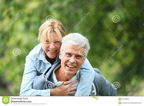 Happy Cheerful Couple, Husband And Wife, Hugging In Old