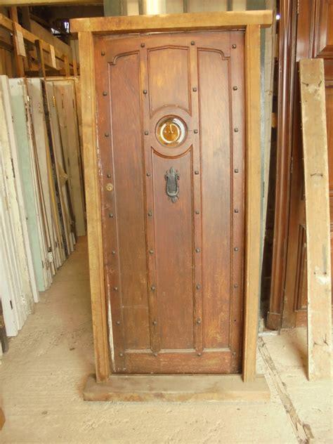 studded oak front door  oval window authentic reclamation