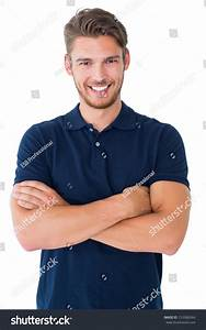 Handsome Young Man Smiling With Arms Crossed On White ...