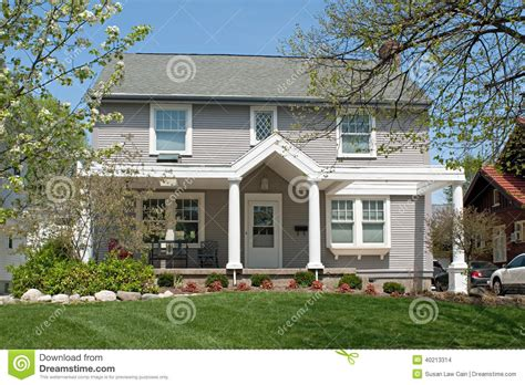tan colonial house  spring stock photo image