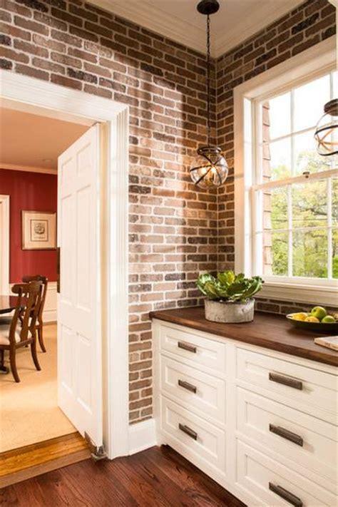 modern kitchen decor  brick walls  interior decorating ideas