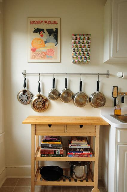 how to live in a small space accessorize your kitchen hang pots and pans from hooks or pot