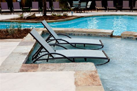chaise lounge chairs in pool water gardens to in