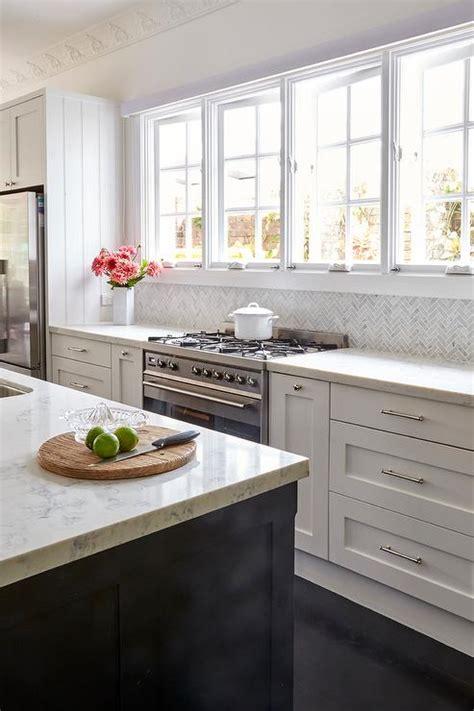 gray marble herringbone kitchen backsplash transitional