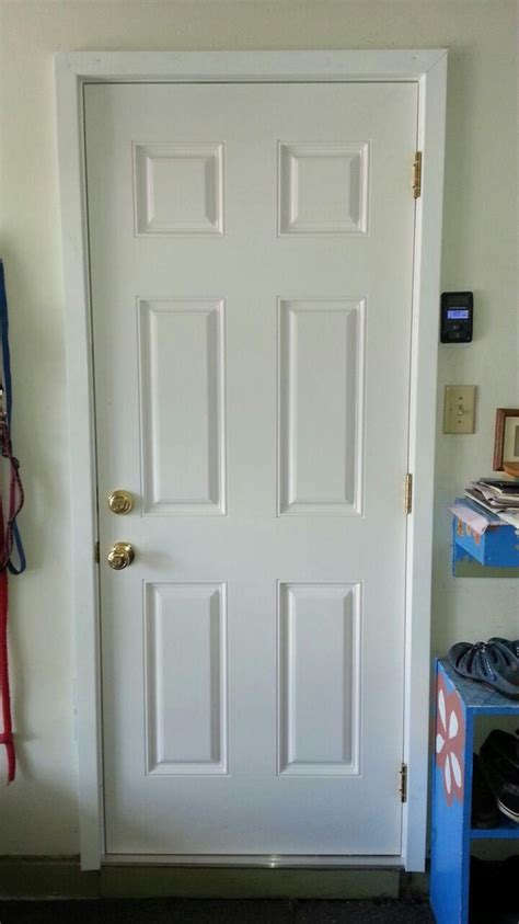 Smooth Fiberglass Outswing Exterior Door Leading To The