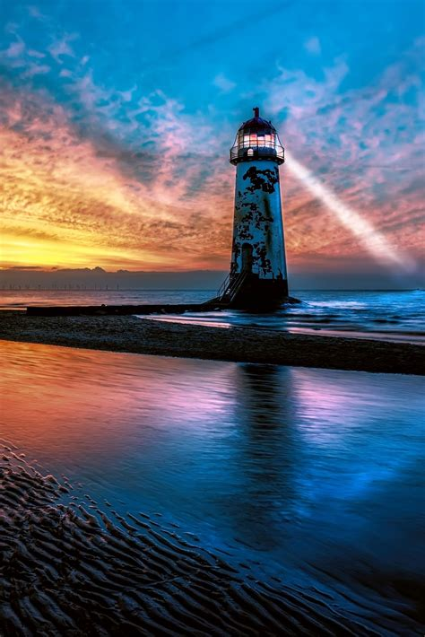 light house sunset  adrian evans light house