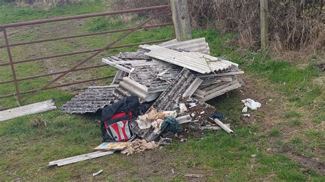 asbestos fly tipping  bedford anglia itv news