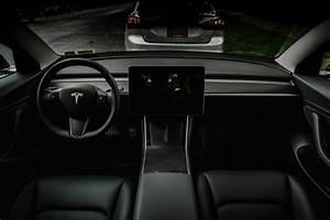 Black interior with woodgrain dash wrapped in vinyl – Tesla Model 3 Wiki