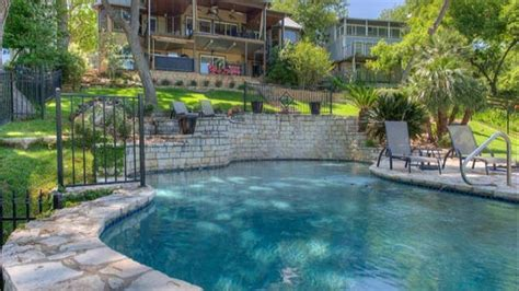 Lake Travis House Rental With Boat Dock lake house with two story boat dock tub with a view