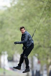 Tom Cruise suspended by a harness and on a motorcycle on ...