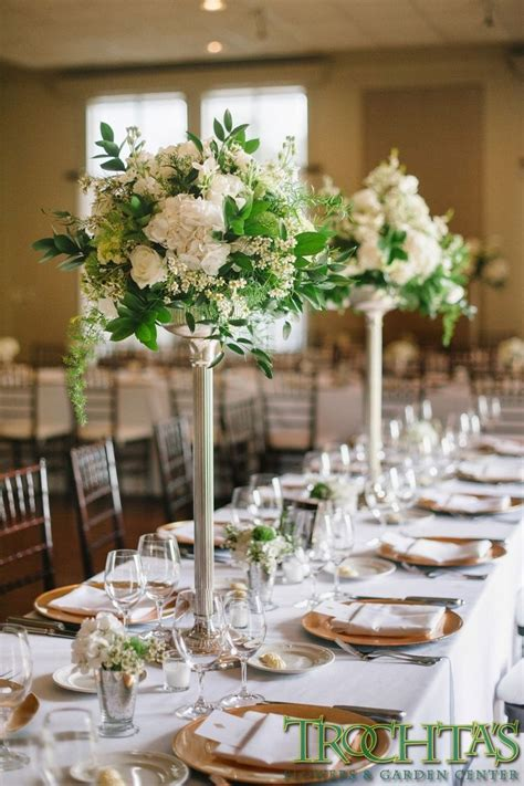 Tall Elegant Table Centerpieces That Have White Wax Flower