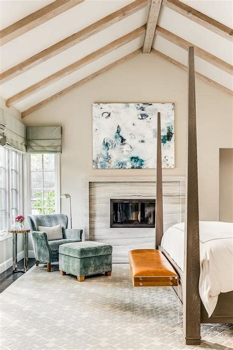 chic bedroom reading corner is filled with a white roll arm chaise lounge draped in taupe wood bed with orange bench transitional bedroom