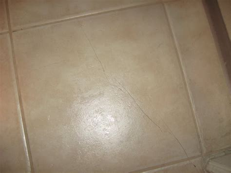 Replace cracked floor tiles or