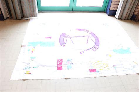 suffrage banner making workshop outdoor blanket kids