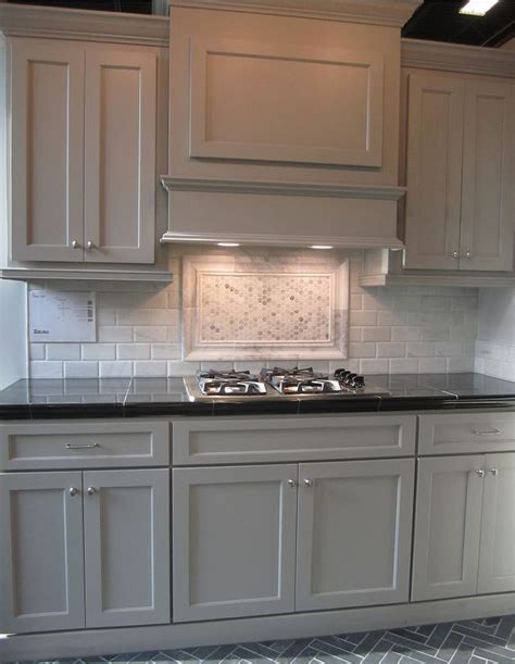 gray cabinets black counters slate herringbone floor marble hex backsplash accent kitchen