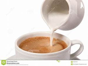 Delicate Cream Poured Into Cup Of Coffee Stock Image ...