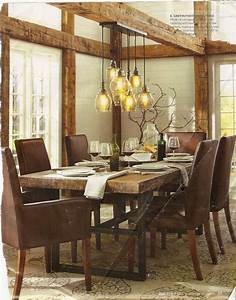 Pottery barn dining room with rustic glass pendant lights