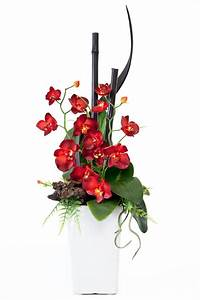 Red and White Orchids | red orchids black bamboo in a ...
