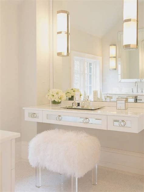 white bathroom vanity with large wall mirror and