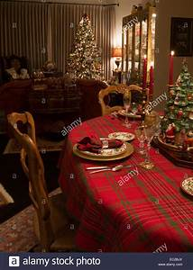 Christmas dinner table set with decorated Christmas tree ...
