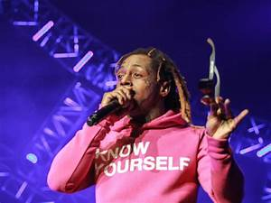 Lil Wayne Accused Of Punching Bouncer | HipHopDX