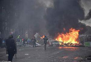 Paris riot police blast water cannon at demonstrators ...