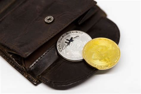 A bitcoin wallet is a software application in which you store your bitcoins. Bitcoins in a physical Wallet - Creative Commons Bilder
