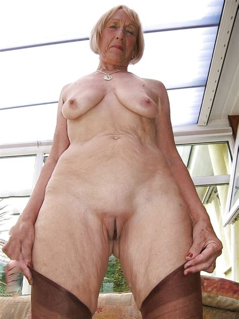 Redhead Granny Is Showing Off Her Tight Shaved Pussy