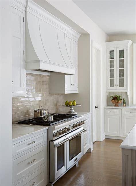 white  taupe kitchen  calacatta gold oval tiles transitional kitchen