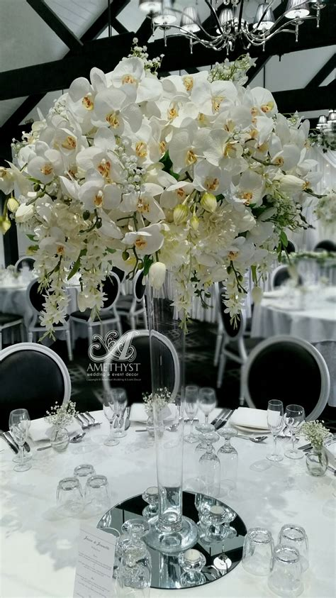 tall white orchid centerpiece  info