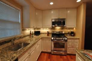 kitchen backsplash with white cabinets kitchen remodel white cabinets tile backsplash undercabinet lighting island traditional