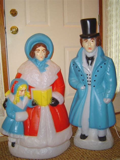blow mold christmas man woman child carolers