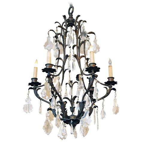 1970s six light floral wrought iron and chandelier