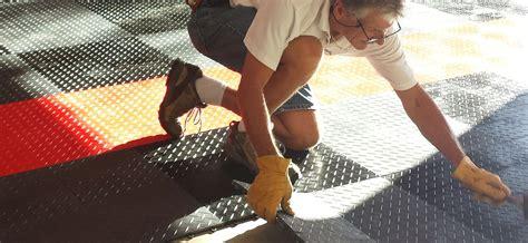 epoxy flooring vs modular garage flooring racedeck