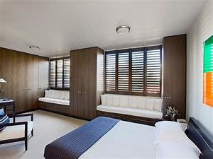 Classic bedroom design idea with wood panelling & window