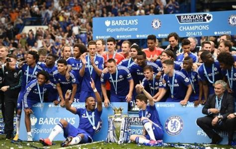 Chelsea celebrate with the trophy after winning the ...
