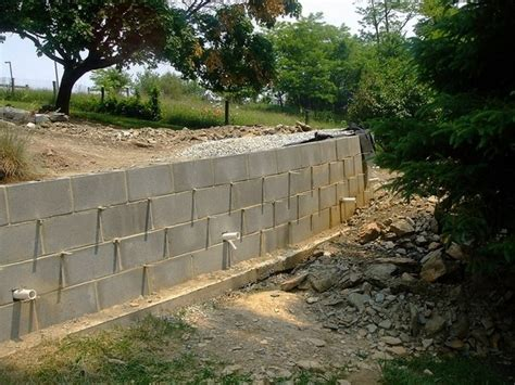 how to build a cement retaining wall how to build a retaining wall concrete blocks drainage pipe yard pinterest drainage pipe