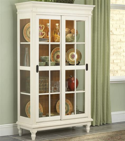 Curio Cabinet With Crown Moulding Turned Feet And