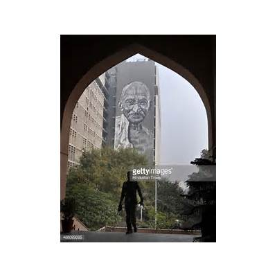 A mural of Mahatma Gandhi being painted on the walls