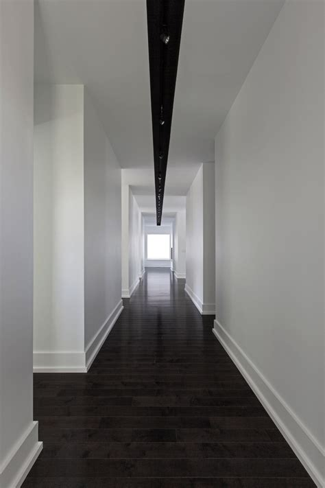 hallway with linear light fixture inspiring ideas