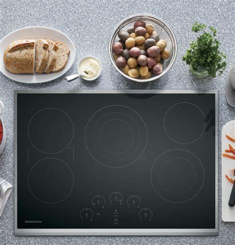 monogram zeursjss   electric cooktop   elements smooth black glass surface