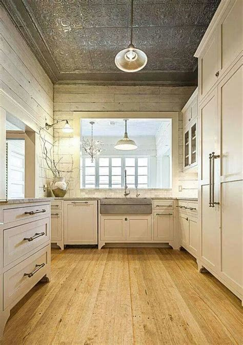 Love the ceiling! Tin Ceiling, plank walls, warm wood