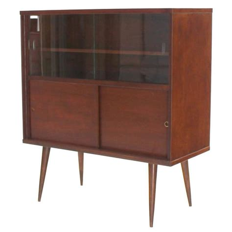 mid century modern walnut cabinet with sliding glass doors