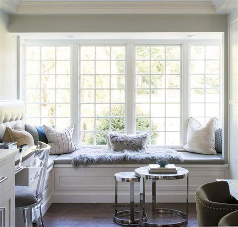 stunning dining room boasts  white  shaped window seat