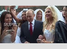Russia Putin mobbed by young models dressed as brides