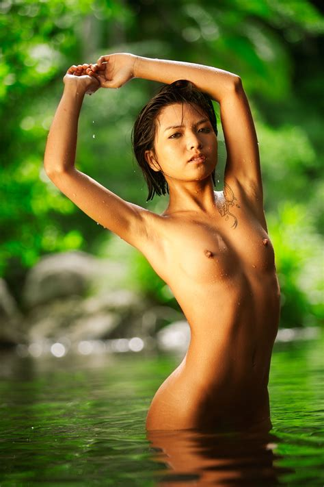 Sexy young vietnamese model nude in nature