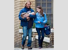 Anna Kendrick and Wyatt Russell cradle infant on Table 19