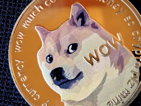 Elon Musk scales back Dogecoin hype while DOGE price ...