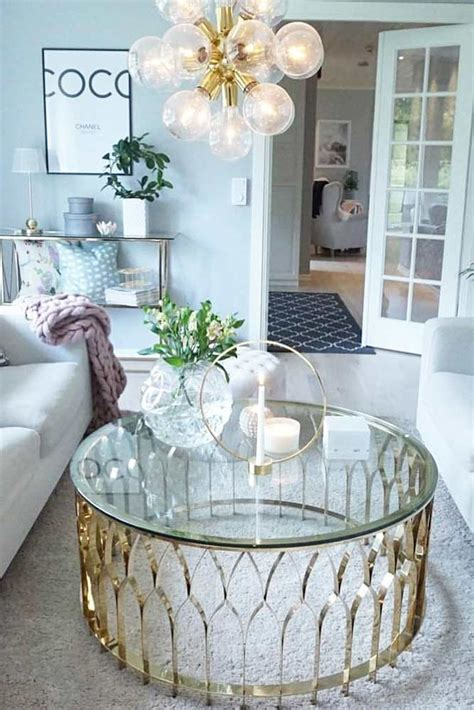 Small round coffee table in the middle can ensure the complete success of the plan. Impeccable Coffee Table Décor For Your Stylish Home | Glaminati.com in 2020 | Round coffee table ...
