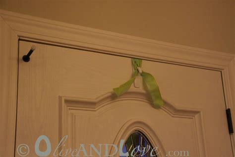 how to hang garland around front door olive and how to hang a wreath on your front door